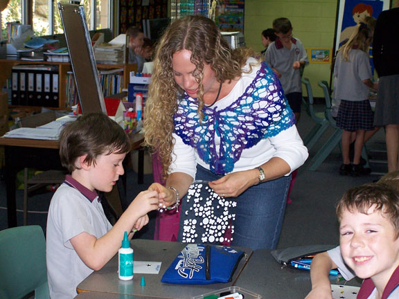 Vanessa our Marketing guru helping students make their Gratitude Coasters